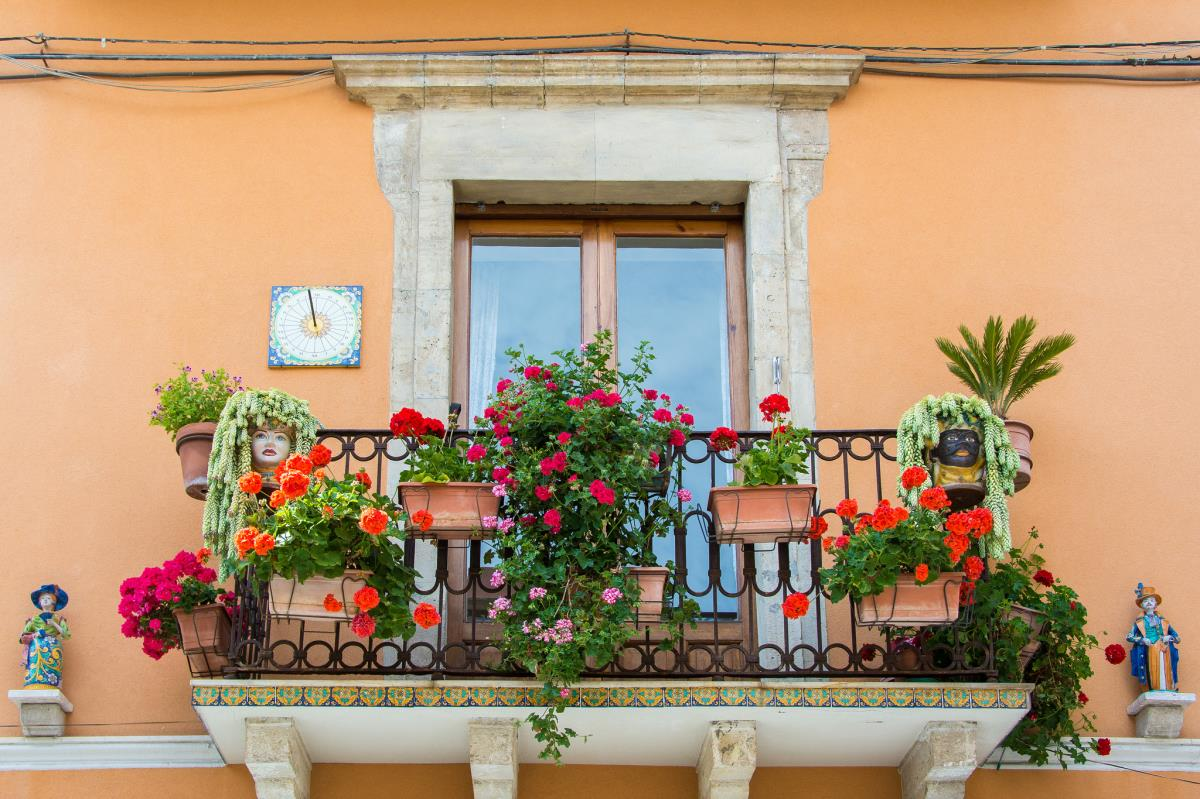 Photo by Esin ?st?n[Balcony in Taormina, Sicily - Italy] CC BY 2.0